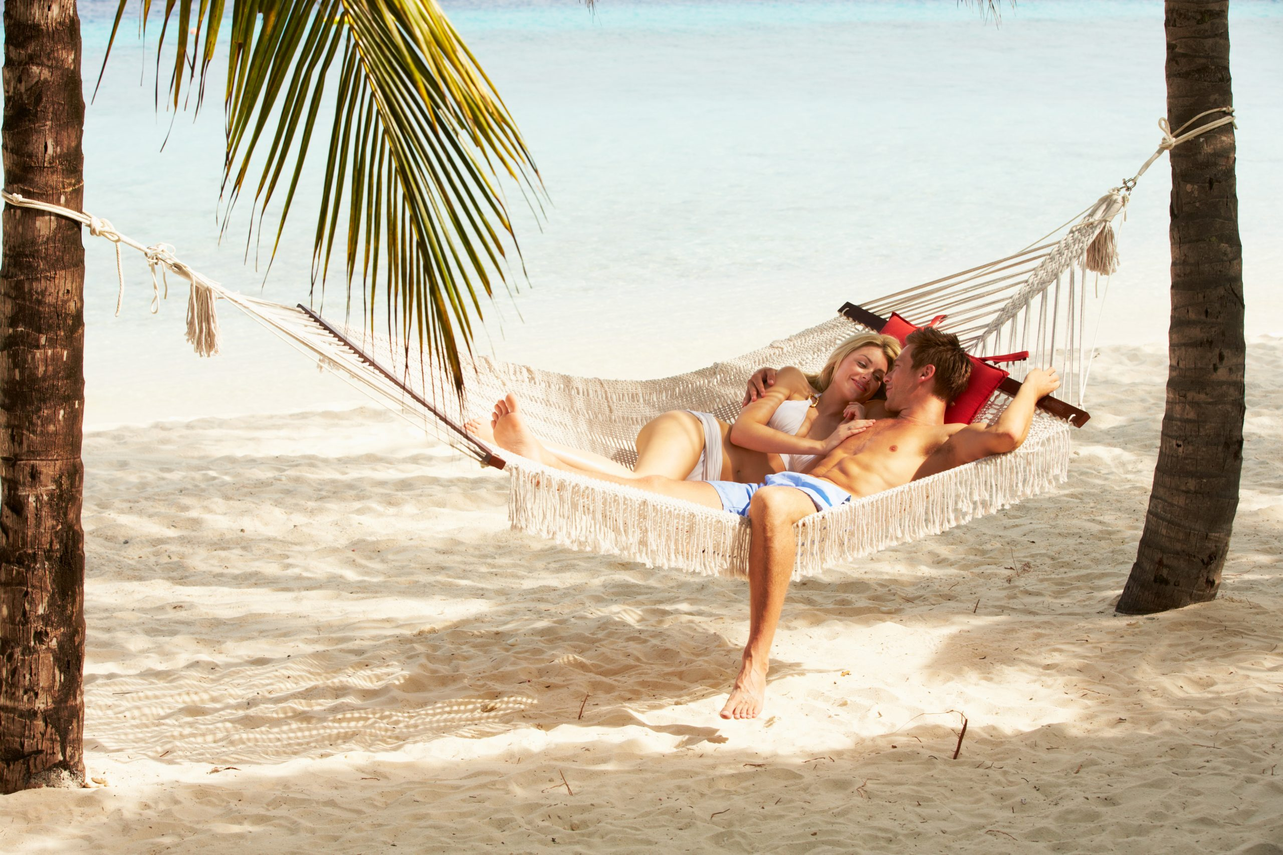 Romantic Couple Relaxing on Beach