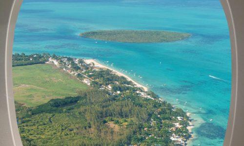 Mauritius Island aerial view through aircraft windows